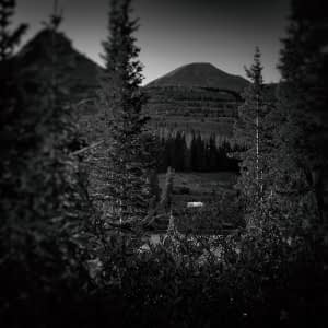 b&w photo of airstream camping in San Juan national forest, Colorado
