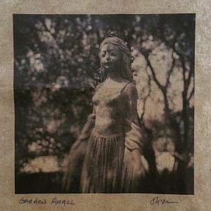 garden angel by Oliver Tollison
